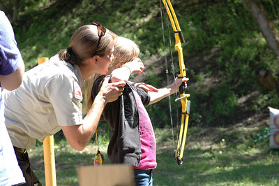 Officer Wangsgard gives archery instruction to a young person at Camp Hobe.  Photo by the Utah Division of Wildlife Resources