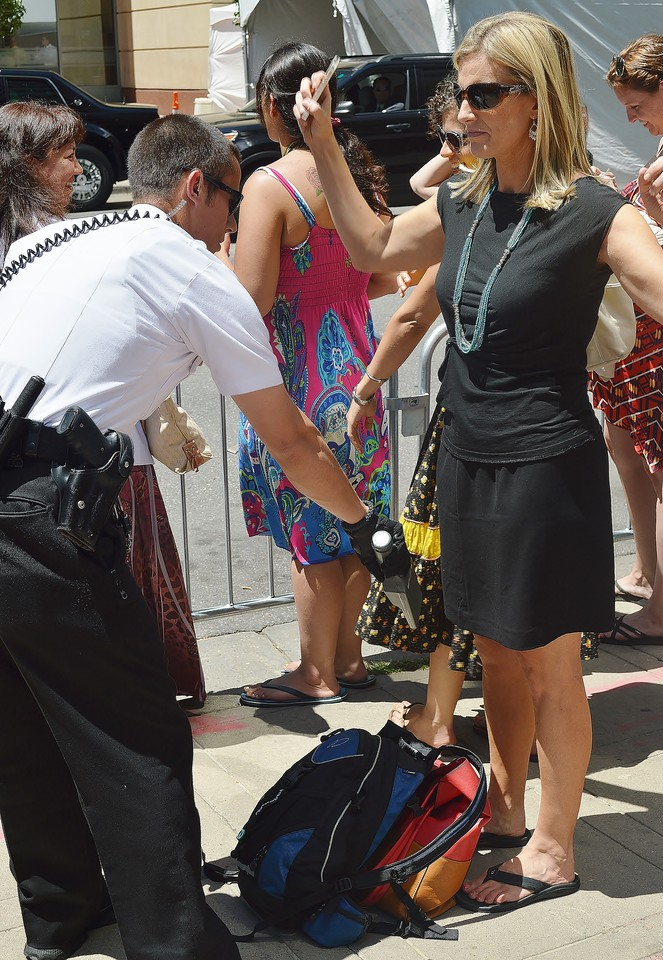 """Secret Service agent using """"wand' to screen woman outside event featuring President Obama."""
