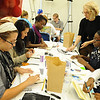 Artist Barb Bondy works on a sketchbook project with W&L art students.