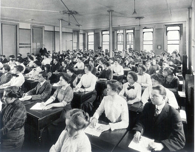 Students attending class during the late 1800s.