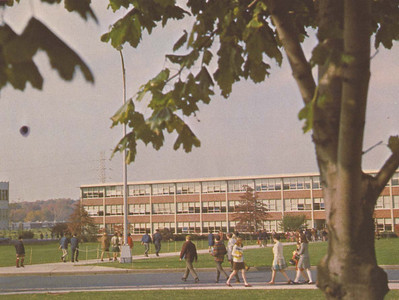Students going to class during the 1960s. Memorial Hall is in the background.
