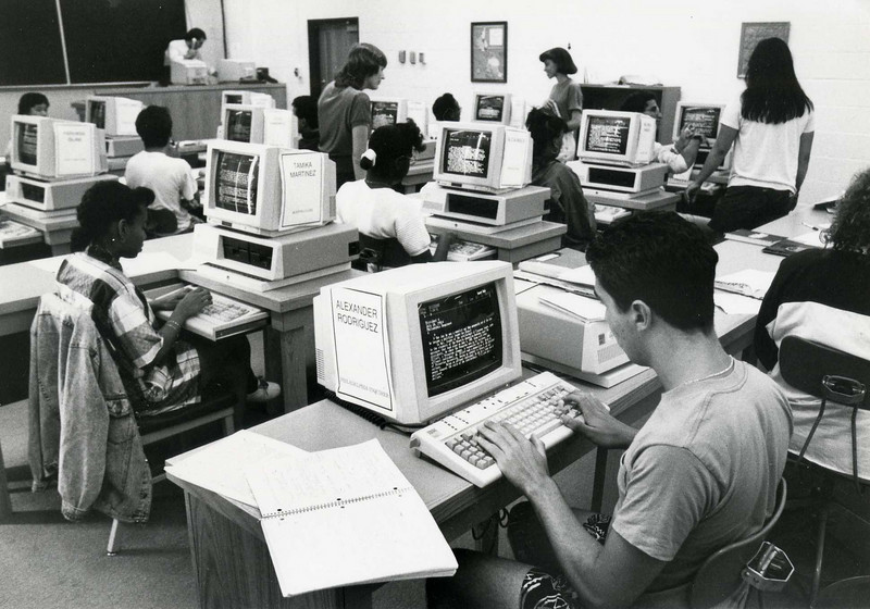 Students working in a computer lab in the early 1980s.