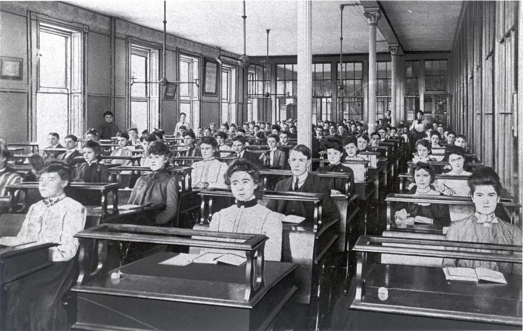 Students attending class circa late 1800s.