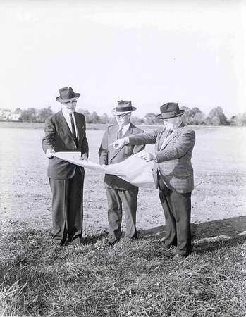 Franklin F. Moore, Captain Raymond Miller, and J. Goodner Gill previewing the architectural master plan for the new campus.