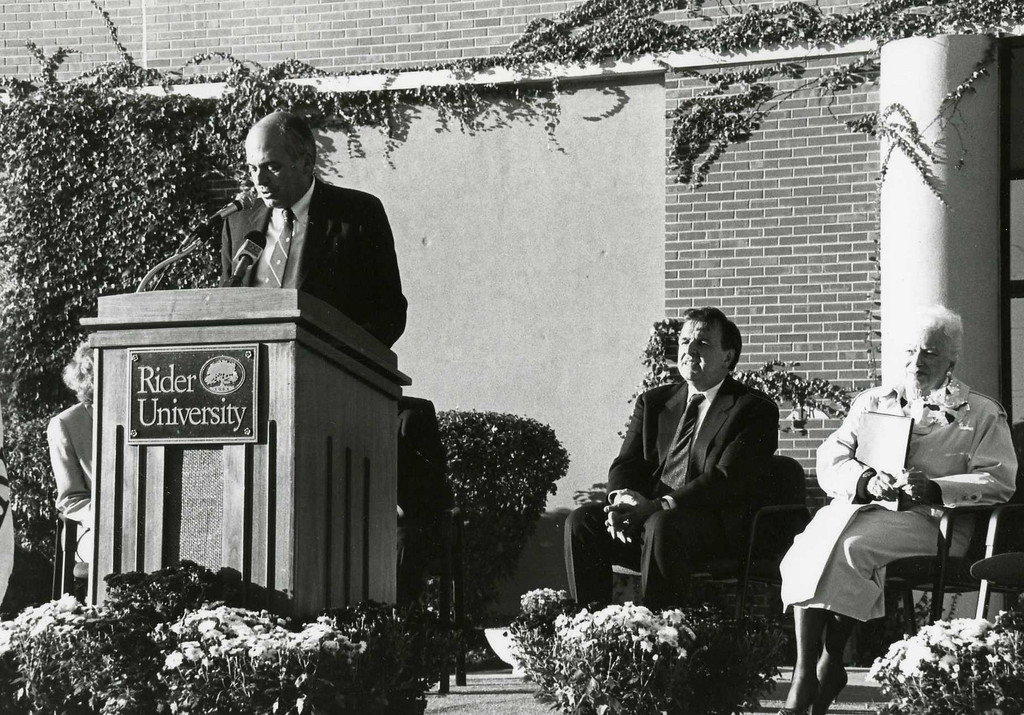 Dr. J. Barton Luedeke, Rider's fifth president, announces the College of Business Administration building to be named Anne Brossman Sweigart Hall, honoring the graduate, Anne Sweigart (far right), of the class of 1934. The re-dedication ceremony occurred on October 1, 1997.