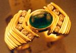 A bezel set cabochon emerald.