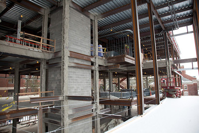 From the bridge lounge looking in to open atrium.  A central staircase will wind around the elevator.  ©Laura Brophy for the University of Rochester