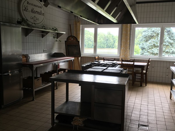 The kitchen comes with the refrigerator, gas stoves, oven, breakfast table and plenty of space for cooking and entertaining