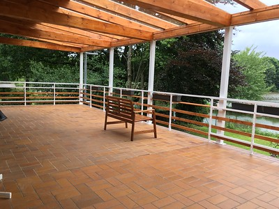 Main terrace with newly built wood roof. We installed half glass and half solid roofing to allow more light on the terrace.