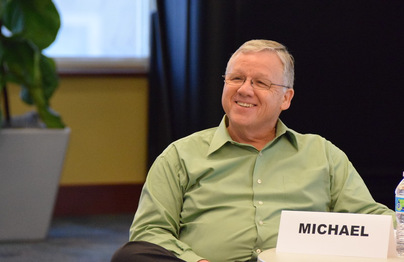 Michael Simpson smiles after answering a question.