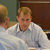 Doug Carpenter (back to camera) listens to Michael Gobber.