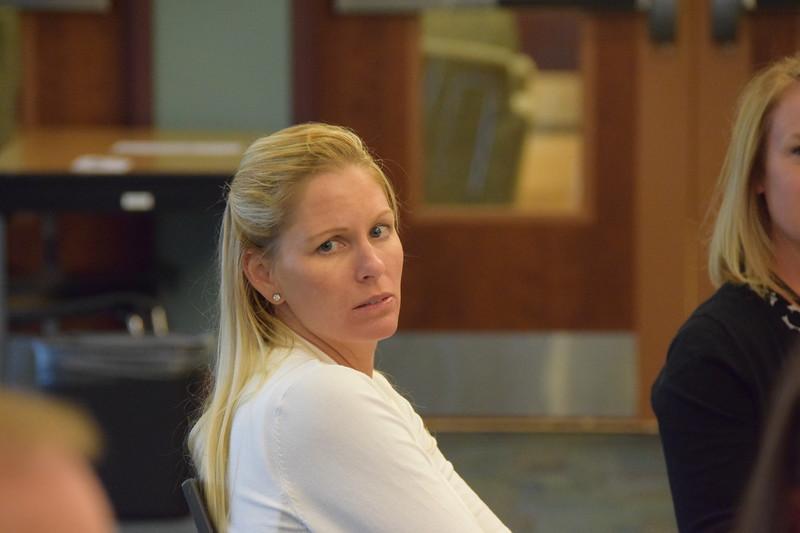 Dena Turner listens to a colleague.