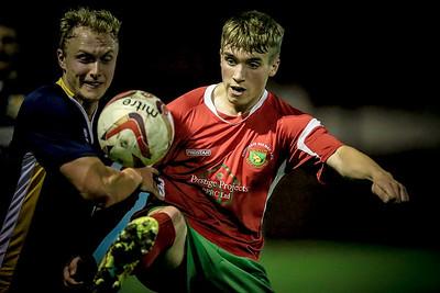 Bradley Sharrocks controls the ball under extreme pressure.