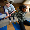 KRISTOPHER RADDER — BRATTLEBORO REFORMER<br /> Johannah Parker, an 11th-grader at Bellows Falls Union High School, has Bilzzi Pacheco, an 11th-grade student at Brattleboro Union High School, get on her knees as students at Windham Career Center's Criminal Justice program learn how to properly handcuff a person with help from the Windham County Sheriff's Department at Brattleboro Union High School on Friday, Feb. 28, 2020.