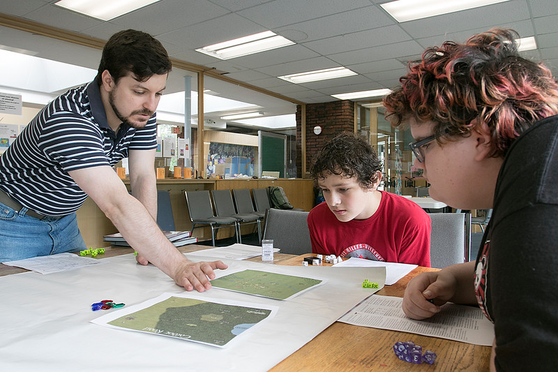 The Fitchburg Public Library held a teen role playing game (RPG) time on Saturday afternoon, August 3, 2019. It was to give players a place to play and for new players to come and learn how to play games like Dungeons and Dragons. Teen Librarian Colin Welch and players Beckett Scott, 13, and Joe Sears, 14, look over a map of the area they are searching as they play D&D at the event.SENTINEL & ENTERPRISE/JOHN LOVE