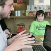 The Fitchburg Public Library held a teen role playing game (RPG) time on Saturday afternoon, August 3, 2019. It was to give players a place to play and for new players to come and learn how to play games like Dungeons and Dragons. New player Airen Ferro, 8, listens to dungeon master Chris Lilja talk about what they see as he learns how to play D&D during the event. SENTINEL & ENTERPRISE/JOHN LOVE