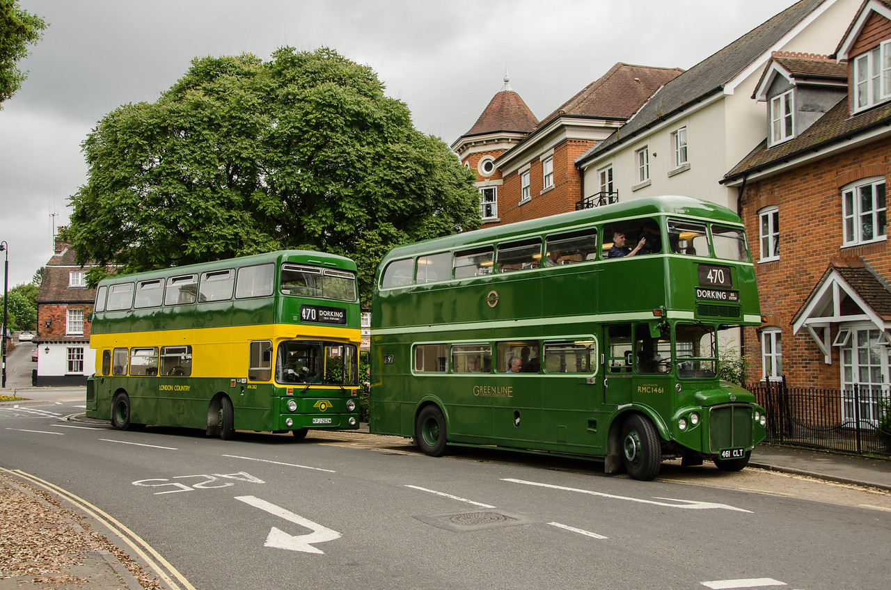 RMC1461 and AN262 stand outside what was the site of Dorking bus station and garage