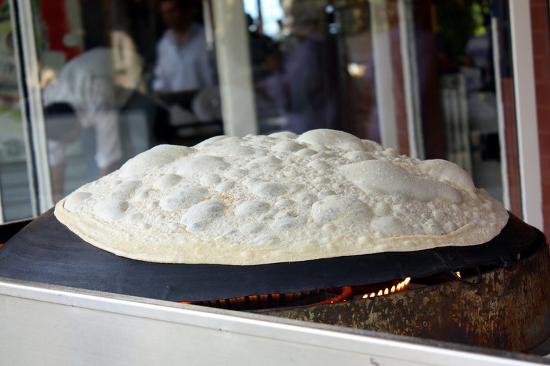 Bread being made at an amazing village style restaurant!