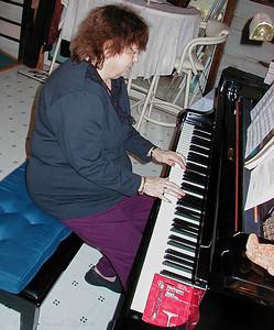 Shirley Lebin playing piano, July 2004.