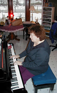 Shirley Lebin playing piano, Lock Haven PA, July 2004.