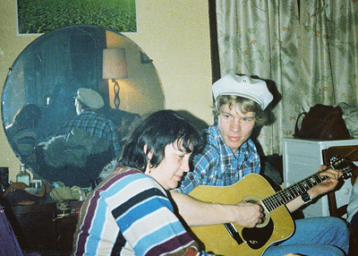 Shirley Lebin, FL on guitar, at a cast party for Passing Through II. Spring 1978