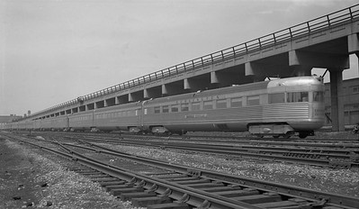 2010.030.01.P.07B--lee hastman 116 neg [Bob Kennedy]--CB&Q--obs passenger car Silver Streak on hind end of Denver Zephyr passenger train 20mph--Chicago IL--1937 0522