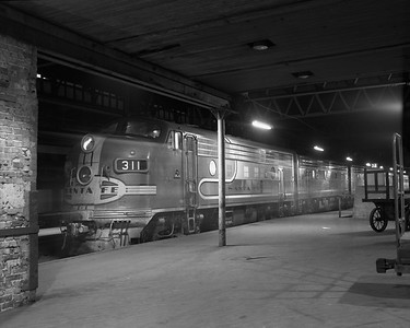 2010.030.09.2.014--lee hastman 4x5 neg--AT&SF--EMD diesel locomotive 311 on passenger train arrived at Dearborn Station--Chicago IL--early 1970s