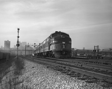 2010.030.09.1.011--lee hastman 4x5 neg--ICRR--EMD diesel locomotive 4041 on southbound passenger train at 18th Street--Chicago IL--early 1970s