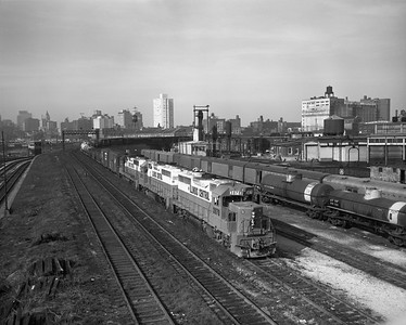 2010.030.09.1.008--lee hastman 4x5 neg--ICRR--EMD diesel locomotive 3071 with freight train coming off St Charles Air Line at 18th Street--Chicago IL--c1972 0000. After Amtrak; note head end cars at right in old Santa Fe coach yard.