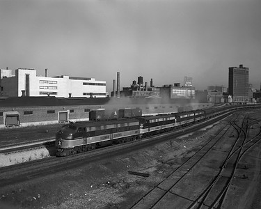 2010.030.09.1.014--lee hastman 4x5 neg--ICRR--EMD diesel locomotive 4027 on southbound passenger train from Central Station about 22nd Street--Chicago IL--early 1970s