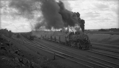 2010.030.04.009--lee hastman 116 neg--DM&IR--steam locomotive 2-8-0 1224 with loaded ore cars freight train action--Virginia MN--1949 0628