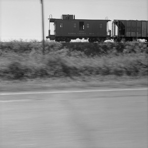 2010.030.05.7.013--lee hastman 120 neg--ICRR-caboose 9818 on hind end of freight train action--location unknown--no date