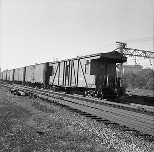 2010.030.05.7.001--lee hastman 120 neg--ICRR--wooden transfer caboose 8042 on hind end of freight train--Chicago IL--no date