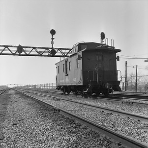 2010.030.05.7.011--lee hastman 120 neg--ICRR--caboose 9725 on rear of freight train--Richter IL--1960s 0000