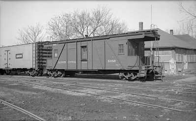 2010.030.05.7.002--lee hastman 6x9 neg--ICRR--wooden transfer caboose 8089--location unknown--1953 0223