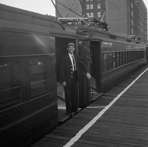 2010.030.05.9.006--lee hastman 120 neg--ICRR--passenger conductor Al Williams on station platform 63rd Street--Chicago IL--no date