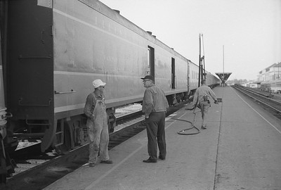 2010.030.05.9.033--lee hastman 35mm neg--ICRR--crew members and Panama Ltd passenger train during station stop at Champaign IL--c1965 0000