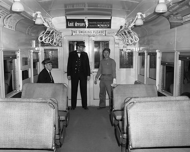 2010.030.05.9.009--lee hastman 4x5 neg--ICRR--passenger conductor Al Williams and Al Shervis on commuter coach on South Chicago line--Chicago IL--1964 1126