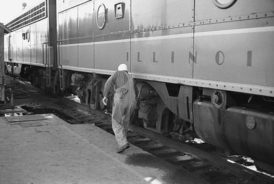 2010.030.05.9.035--lee hastman 35mm neg--ICRR--crew inspecting Panama Ltd passenger train during station stop at Champaign IL--c1965 0000