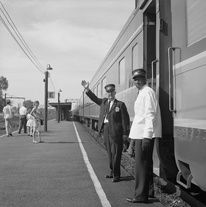 2010.030.05.9.004--lee hastman 120 neg--ICRR--passenger conductor and porter on station platform--Homewood IL--mid 1960s 0000