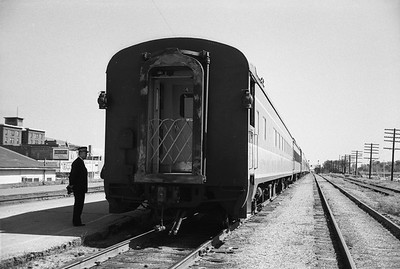 2010.030.05.9.026--lee hastman 35mm neg--ICRR--hind end of passenger train Louisian 4--Champaign IL--1965 0000