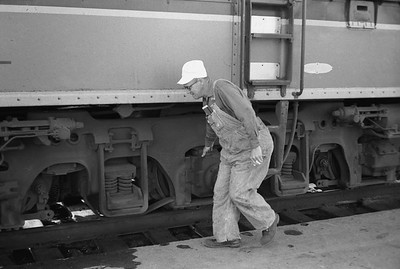 2010.030.05.9.034--lee hastman 35mm neg--ICRR--crew inspecting Panama Ltd passenger train during station stop at Champaign IL--c1965 0000