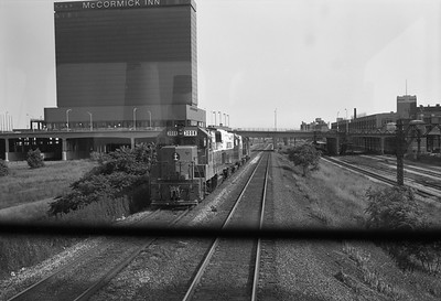 2010.030.05.8.006I--lee hastman 6x9 neg--ICRR--EMD diesel locomotive 3088 with caboose hop as seen from switch engine cab--Chicago IL--c1972