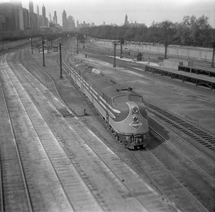 2010.030.05.8.005A--lee hastman 120 neg--ICRR--EMD diesel locomotive light consist scene looking north from 12th Street Central Station yard--Chicago IL--1947 0000