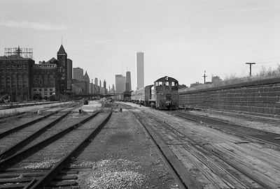 2010.030.05.8.006A--lee hastman 6x9 neg--ICRR--12th Street yard scene with Central Station demolition--Chicago IL--c1972