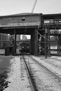 2010.030.05.8.005K--lee hastman 6x9 neg--ICRR--12th Street yard scene with Roosevelt Road walkways and approaching CSS&SB interurban--Chicago IL--1972 0000