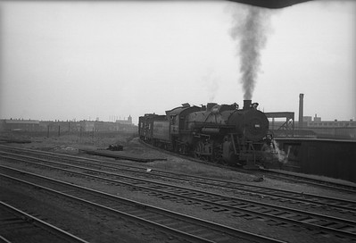 2010.030.05.3.015--lee hastman 6x7 neg--ICRR--steam locomotive 0-8-2 3685 with freight cars exiting Iowa Division entering GM&O--Chicago IL --no date