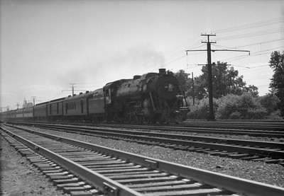 2010.030.05.3.027--lee hastman 6x9 neg [Charles Buccola]--ICRR--steam locomotive 4-8-2 2301 on NYC passenger train action--south side Chicago IL--1949 0801