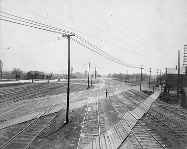 2010.030.CC.021--lee hastman collection cabinet card--PCC&StL CTT--view showing Western Ave crossing tracks looking south--Brighton Park IL--c1903 0000