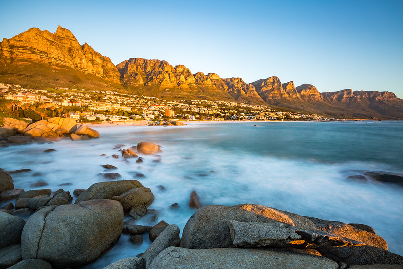 Long exposure at sunset in Camps Bay. Table Mountain and its Cable car on the left and the 12 Apostles to the right.